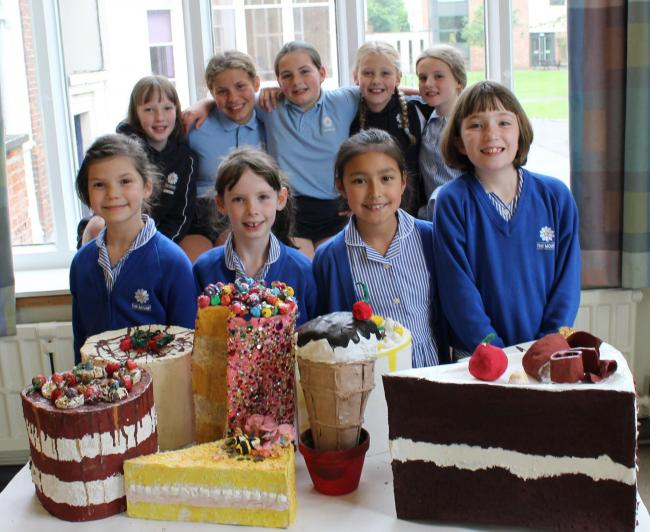STAR PUPILS: Junior School LAMDA pupils pose with giant-sized cake sculptures created by Mount senior school pupils