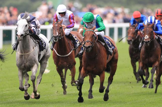 Lord Glitters, ridden by jockey Daniel Tudhope (left) on his way to winning the Queen Anne Stakes during day one of Royal Ascot. Picture: Mike Egerton/PA Wire