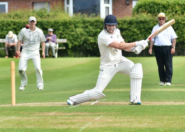 ON THE BALL: The bowling of Stamford Bridge's Des Healey (here at bat) was important in his table-topping side's victory at the weekend. Picture: David Harrison
