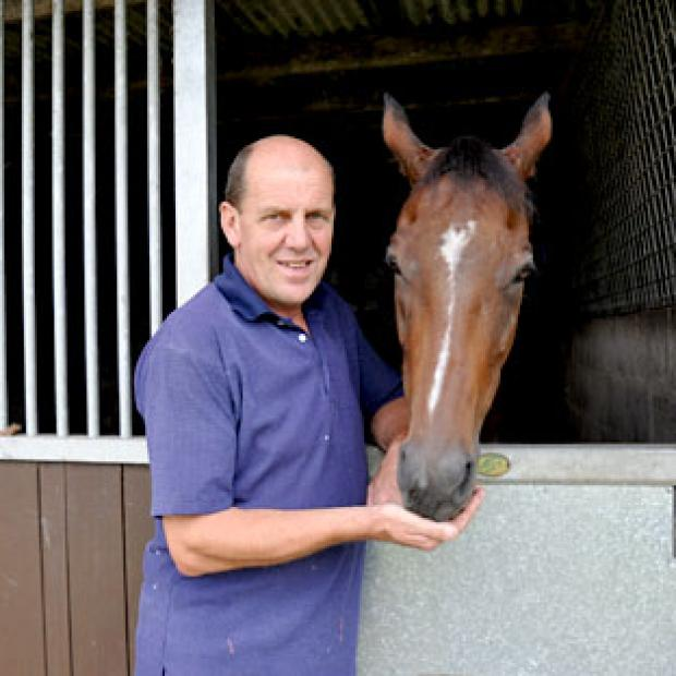 Borderlescott with trainer Robin Bastiman at his Cowthorpe stables