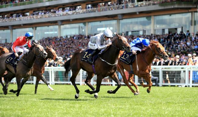 TOP SPOT: Space Traveller, ridden by jockey Danny Tudhope (14), on the way to winning the Jersey Stakes during day five of Royal Ascot. Picture: Adam Davy/PA Wire