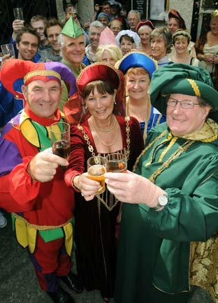 Jill Burnett, centre, the Sheriff of York, with her consort Tony Burnett, left, and the Lord Mayor of York, John Galvin, right, toast the Assize of Ale in York.