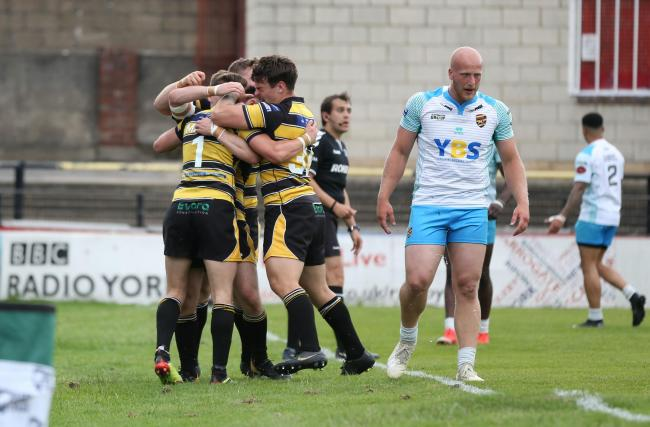 York City Knights celebrate their last-gasp try that stole victory over Dewsbury Rams from the jaws of defeat. Picture: Gordon Clayton