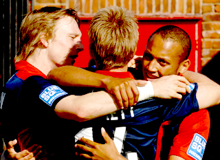 York City goalscorer Adam Smith, right, is congratulated by Daniel Parslow, left, and Neil Barrett