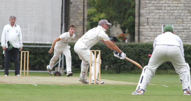 Pickering batsman Colin Frank swipes at a wide ball from Easingwold's Josh Sargent..Picture: Richard Doughty Photography.