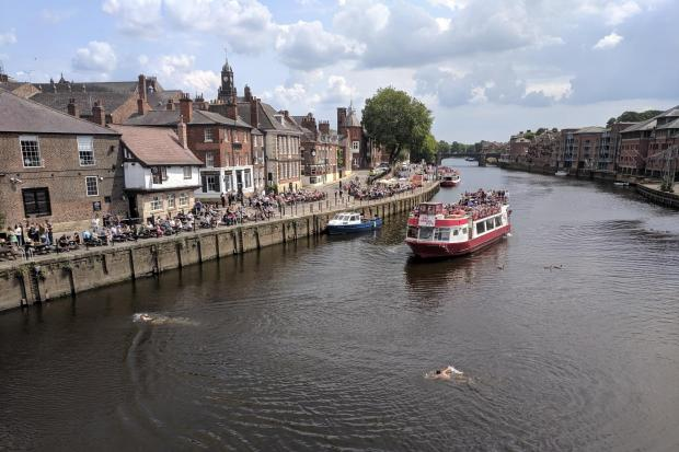 SHOCKING: Two men cross the Ouse, with a cruiser heading towards them