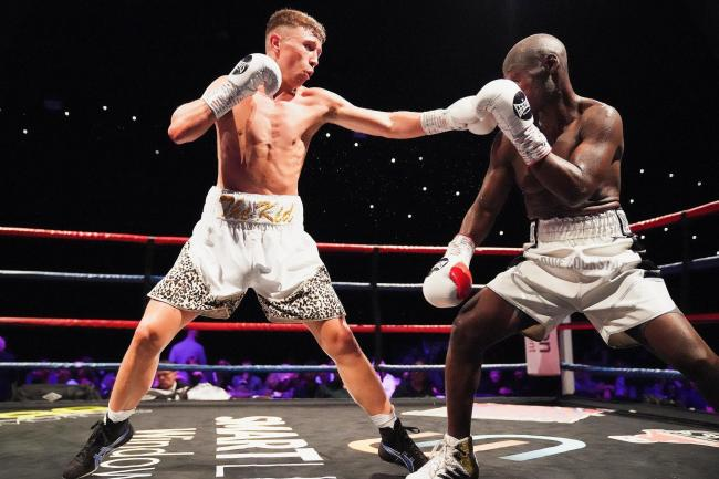 Boxer Cam Shaw, left, in action on his professional debut against Edward Bjorklund. Picture: Andrew Saunders (Sporting Captures)