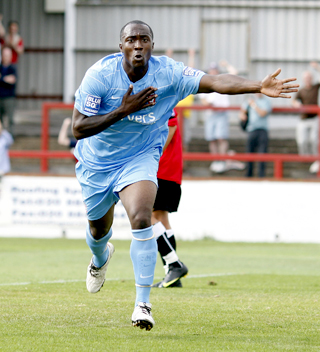 City striker Richard Pacquette celebrates  his leveller  at Hayes on Saturday