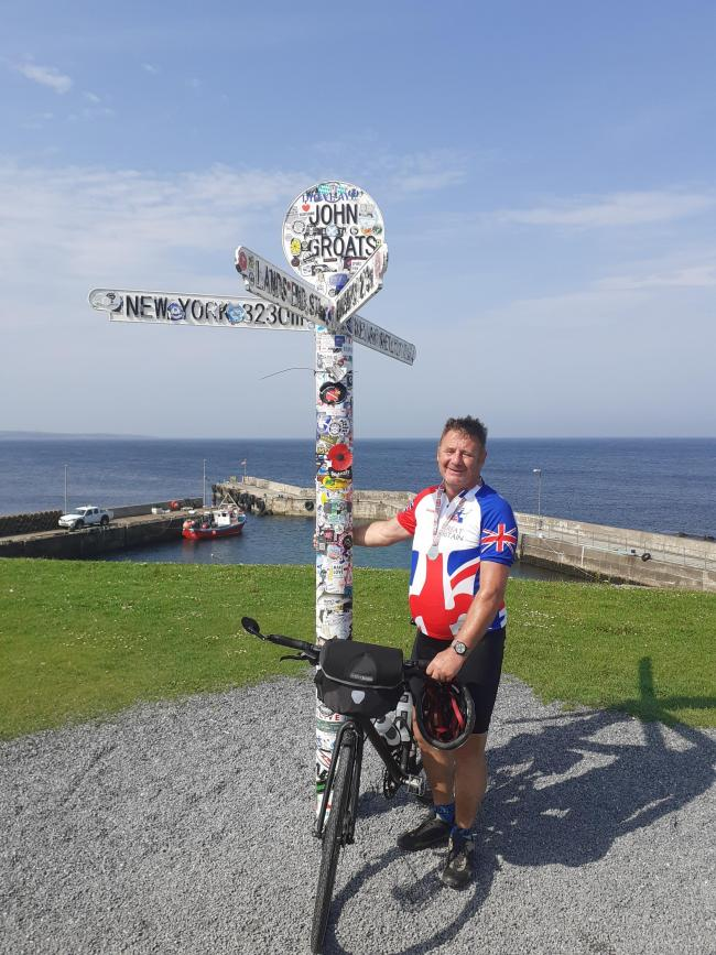 Michael Hammill, pictured at John O'Groats at the end of his ride