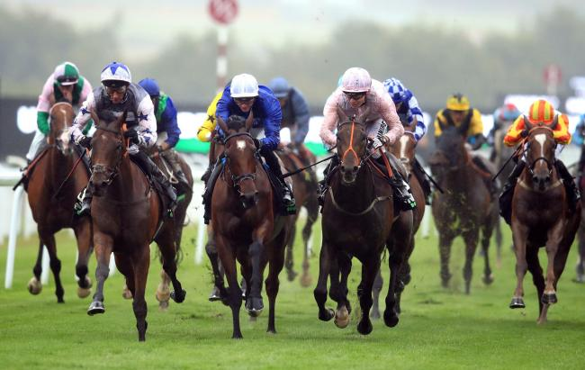Fayez ridden by Jockey Daniel Tudhope (left) on the way to winning the Unibet Handicap during day one of the Qatar Goodwood Festival at Goodwood Racecourse. Picture: PA