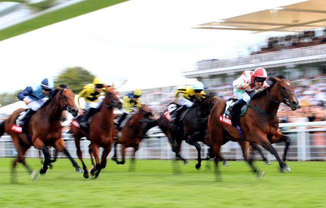 Liberty Beach, ridden by jockey Jason Hart, right, wins the Markel Insurance Molecomb Stakes on day two of the Qatar Goodwood Festival. Picture: Adam Davy/PA Wire