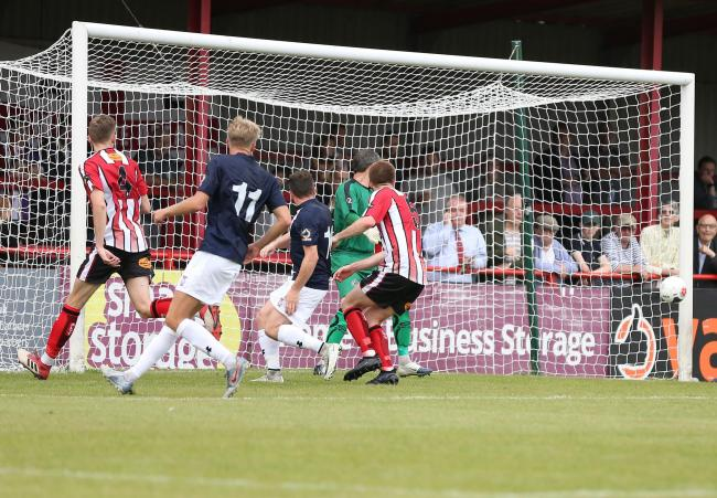Players watch as a David Ferguson cross goes in for York City at Altrincham on the first day of the season. Picture: Gordon Clayton