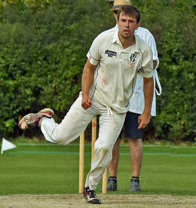 Pickering batsman Keiran Boyes is bowled by Woodhouse Grange bowler Matthew Shepherd watched by wicket keeper  Richard Winterburn.Pic Nigel Holland.