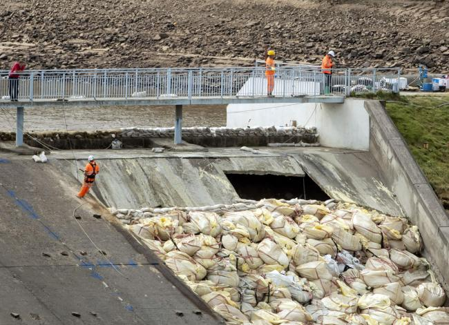 Work continues to shore up the dam at Toddbrook Reservoir near the village of Whaley Bridge, Derbyshire, after it was damaged in heavy rainfall. Picture: Danny Lawson/PA Wire