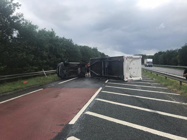 The overturned caravan on the A64 near Malton  Picture tweeted by police