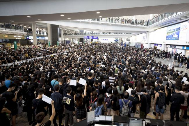Protesters demonstrating at the airport in Hong Kong on Monday in a protest against a proposed extradition law.  Picture: AP Photo/Vincent Thian