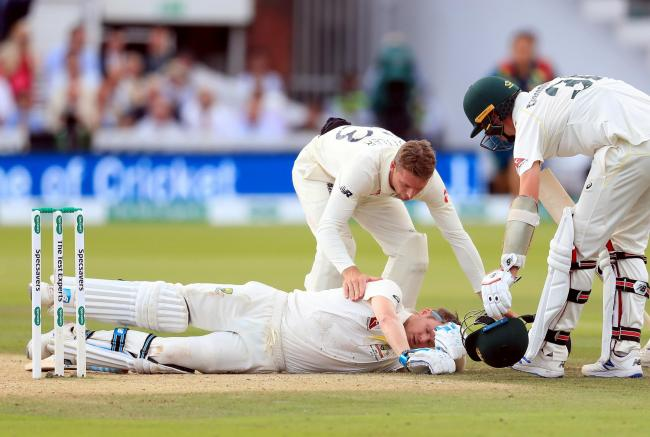 Australia's Steve Smith ends up on the floor after being hit by the ball during day four of the Ashes Test match at Lord's. Picture: Mike Egerton/PA Wire