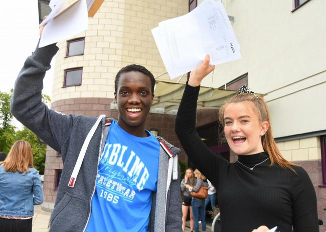 Huntington School pupils Jeremy Muluka and Lucy Jones celebrating on GCSE results day  Picture: David Harrison