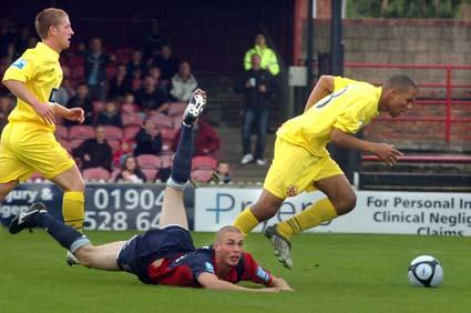 York City's Richard Brodie is sent tumbling to the ground in the match against Crawley Town. York won 2-0.