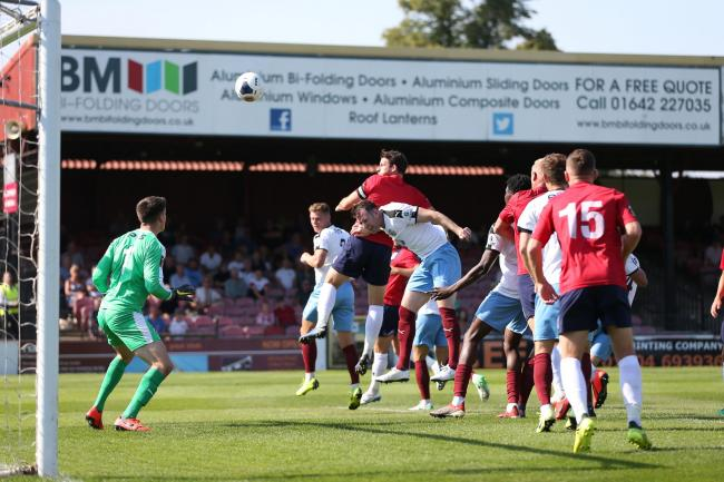 Wearing the captain's armband in the injured Steve McNulty's stead, Sean Newton heads over during York City's 1-1 draw with Gateshead on Bank Holiday Monday. Picture: Gordon Clayton
