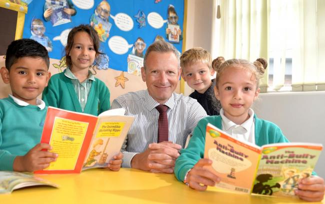 Matt Brown the new head teacher at Osbaldwick Primary Academy in York with pupils