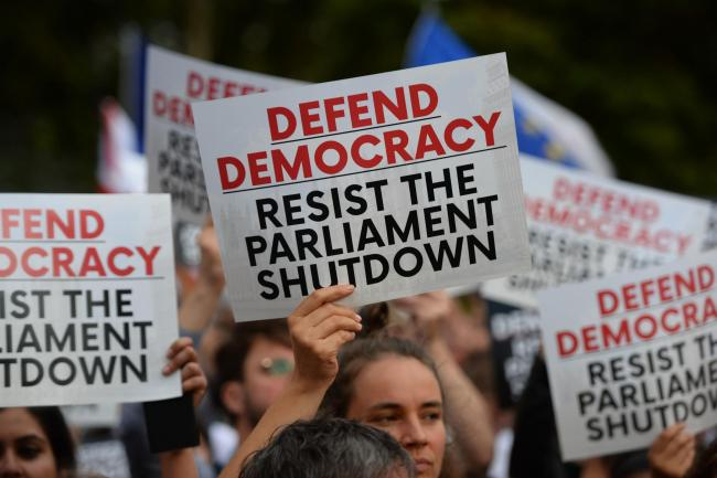 Protestors demonstrate outsides the Houses of Westminster yesterday against Prime Minister Boris Johnson temporarily closing down Parliament. Picture: Kirsty O'Connor/PA Wire