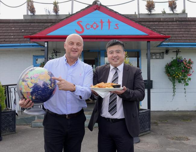 East meets west as Scotts Fish & Chips opens its first franchise in China. Pictured outside the A64 restaurant near York, owner Tony Webster with Will Zhuang who manages Chinese social media for Visit York and Leeds City Region