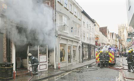 Firefighters tackle the blaze at Petergate Fisheries in Low Petergate, York.