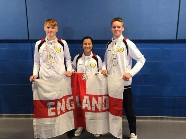 Harry Hardcastle, Amy Tegetmeier and Sam Peacock (left to right) pose with their Japan Karate Shoto Championship medals.