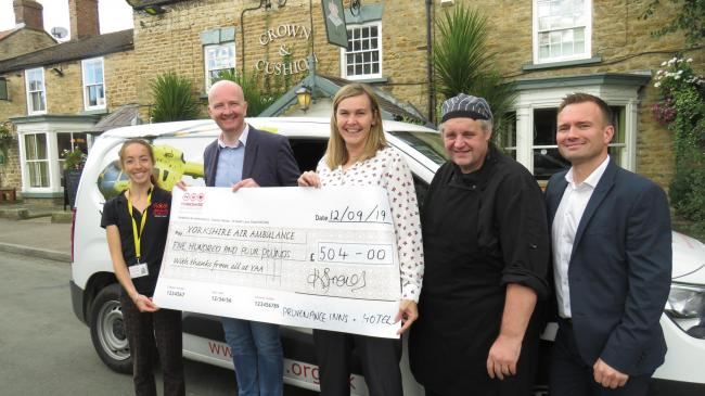 At the cheque handover at the Crown & Cushion in Welburn are Olivia Mulligan, from Yorkshire Air Ambulance, Jason Wardill, group chef of Provenance Inns & Hotels, Karen French, operations director for Provenance Inns & Hotels, Justin Browning,