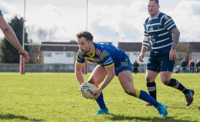 York Acorn hooker James Mountford runs at the Featherstone Lions line. Picture: Jonathan Buck