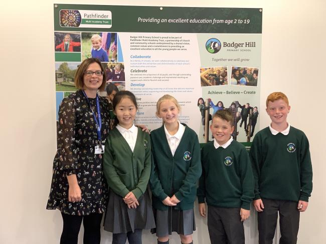 Badger Hill head teacher Vicky Whittingham with pupils celebrating their good Ofsted