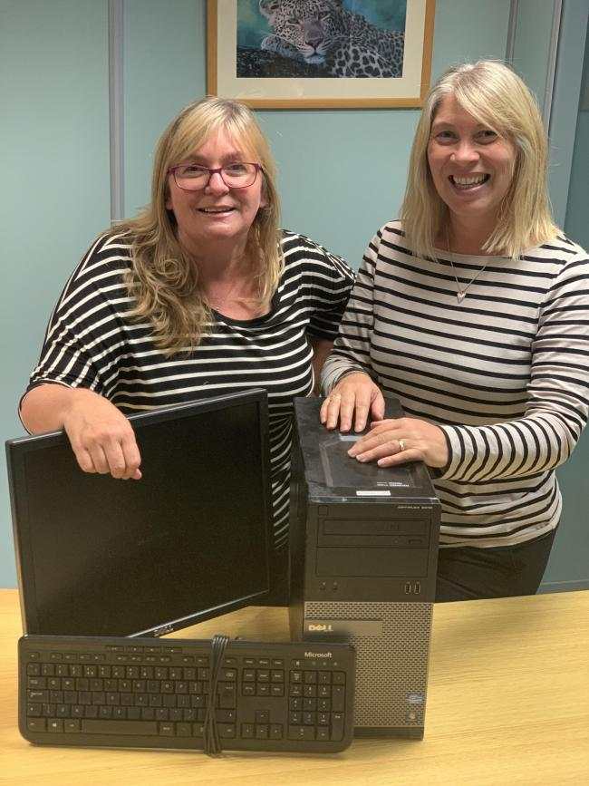Reservations manager Carole McFadden, left, and Karen Pratt, tours consultant, at African Pride who are sending their old IT equipment to be used in Africa