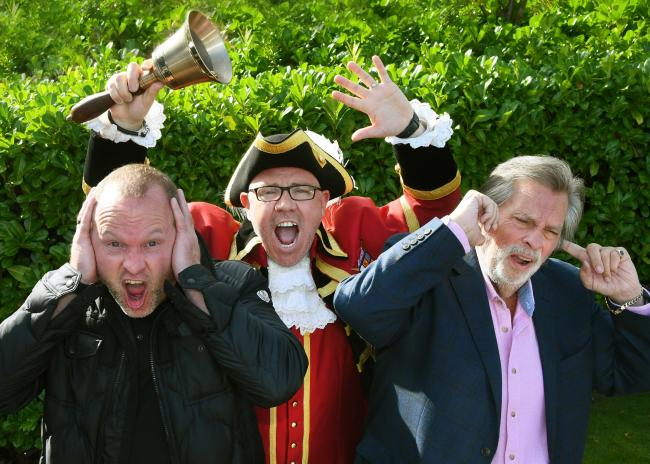 York Town Crier Ben Fry shouts out his joy at the panto news with Three Bears Productions' producers Stuart Wade, left, and Chris Moreno covering their ears Picture: David Harrison
