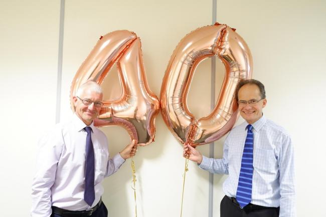 John Lowe and David Greenwood both toast their 40th work anniversary