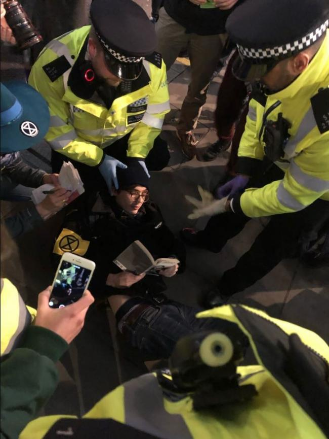 An Extinction Rebellion protester  being picked up by police earlier this year  Picture: Extinction Rebellion