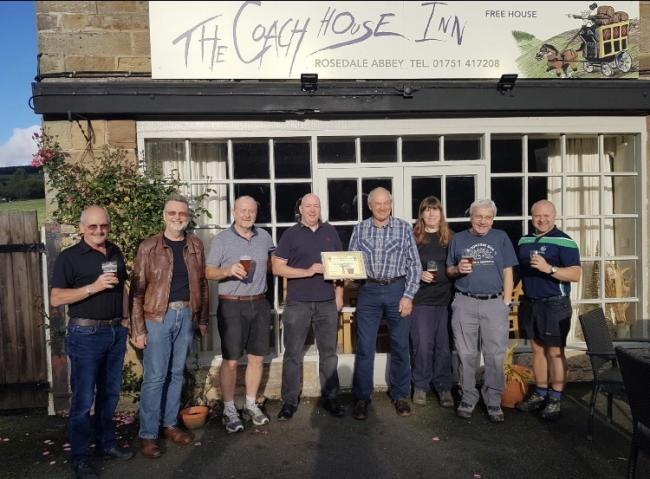 Members of the York branch of CAMRA , Coach House Inn customers and landlord Dave Oakey receiving the Town and Country Pub of the Season award