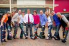 Rupert Griffiths, head teacher of St Oswald's Primary School, centre, and colleagues with their customised jeans