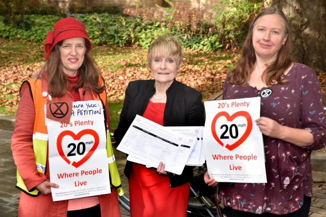 Anna Semlyen and Meg Thomas of the 20's Plenty group hand in a petition to Councillor Fiona Fitzpatrick (centre) at West Offices in York. Picture: Frank Dwyer