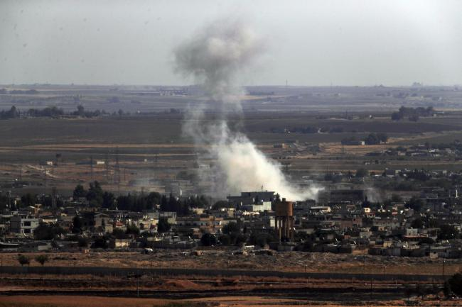 Turkish forces bombard suspected Syrian Kurdish positions at Ras al-Ayn, Syria. AP Photo/Lefteris Pitarakis