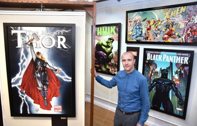 Stuart Whittaker of Castle Fine Art Gallery with the latest prints signed by Stan Lee to go on sale   Picture: Frank Dwyer