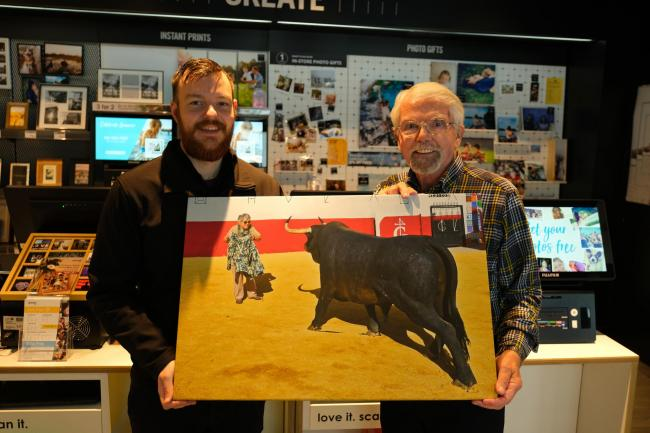 Barney Sharratt receiving his canvas print from Darrell Mitchell, academy support tutor at Jessops in Coney Street