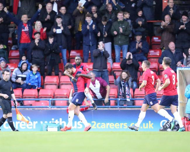 York City's Sean Newton and Adriano Moke celebrate a goal against Stockport County. Picture: Gordon Clayton