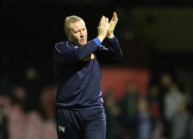 York City manager Steve Watson applauds the fans at Bootham Crescent. Picture: Gordon Clayton