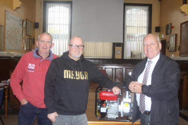 From left: Pocklington town councillor Martin Cooper, Cllr Hodgson and Cllr Stathers with one of the new pumps.