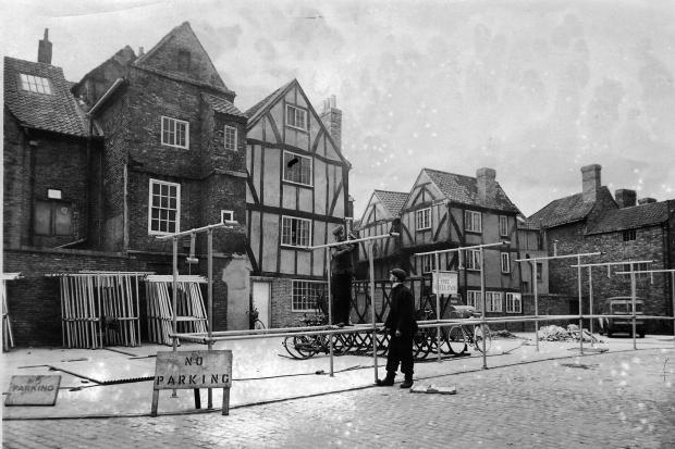 6 December 1955 - Workmen erect the first of the 40 tubular framed stalls in what will become York's market behind the Shambles