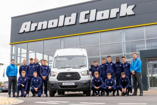 York City Academy and youth players with their minibus from sponsors Arnold Clark