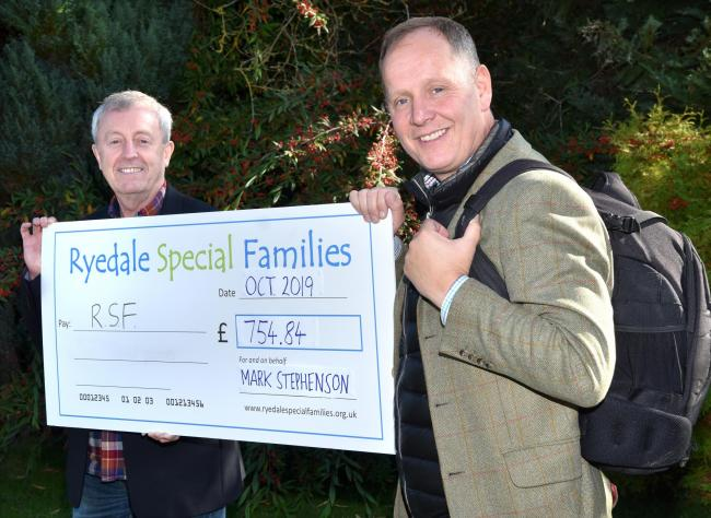 Rob Davies, left, of Ryedale Special Families, receives a cheque from Mark Stephenson of Mark Stephenson Estate Agents, after his walk in aid of the charity      Picture: Frank Dwyer