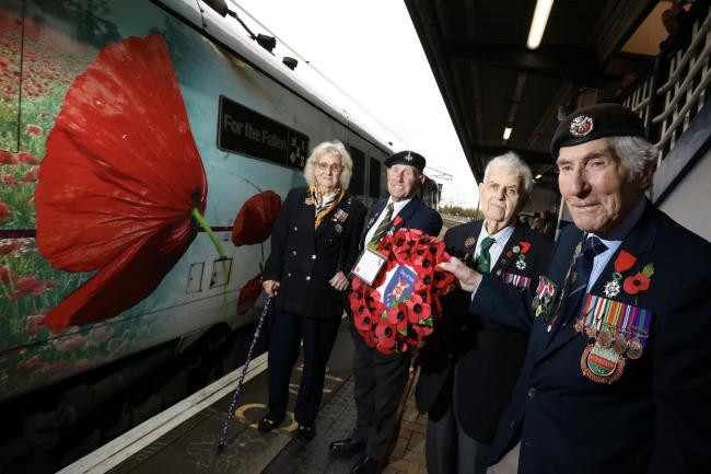 Elsie Johnson, Ken Smith, Sid Metcalfe and Ken Cooke, by the For the Fallen train Picture: LNER