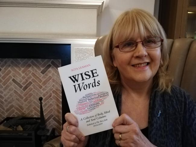 Rita Leaman with her new book